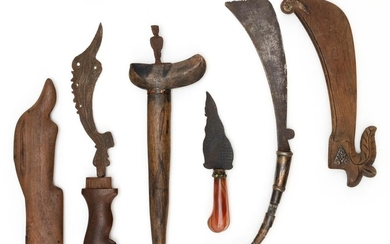 """FOUR INDONESIAN CEREMONIAL KNIVES, DAGGERS AND KRIS Includes a circumcision knife. Three with wooden scabbards. Lengths from 5.5"""" to..."""