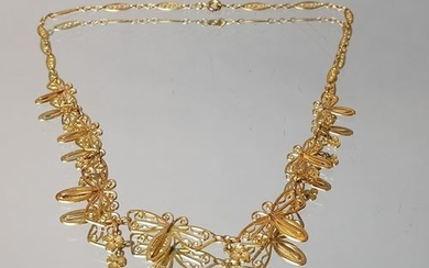 Filigree gold necklace decorated with butterflies alternating with...