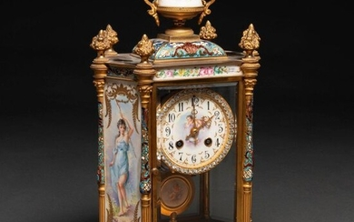 French table clock from the Napoleon III period made of gilded bronze, cloisonne enamel and enamelled porcelain plates. XIX century