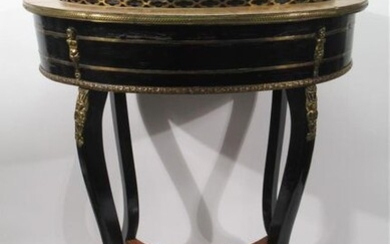 GARDENERY in blackened wood and veneer oval-shaped discovering a sheet metal basin with its cover, rests on four console legs connected by a spacer shelf. Decorated with gilded bronze friezes and small brass putti.