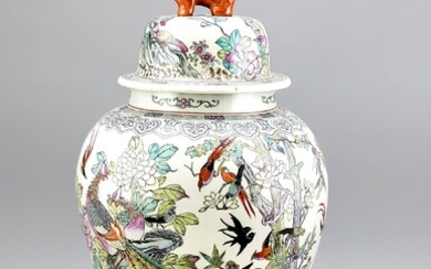 Large floor vase with Lid and Fo Dog Knob, China, mid-20th century. Circular, polychrome decoration in enamel painting with a variety of birds in a flowering bank landscape. The decoration is continued on the bell-shaped lid, red 6-character mark, h...