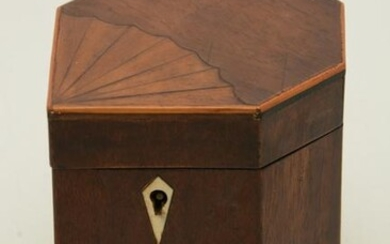 Mahogany and inlaid tea caddy in unusual seven-sided