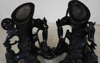 Pair of Japanese bronze stump vases, stylised in the form of...