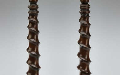 """Pair of carved walnut candlesticks, 20""""h"""