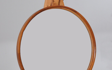 ROUND MIRROR, JAKARANDA AND LEATHER, possibly luxury.