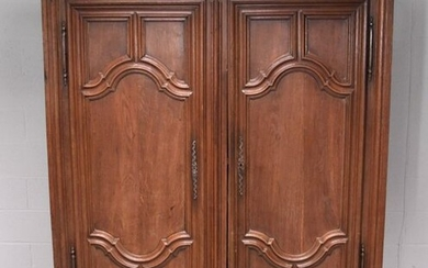 Rustic oak cupboard in Louis XIV style from the 18th century, composed of 2 moulded doors and 2 drawers at the bottom.