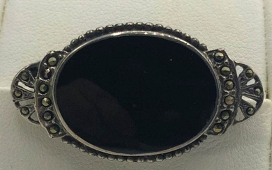 STERLING AND MARCASITE BROOCH WITH BLACK STONE