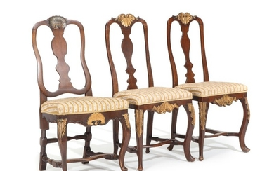 Three 18th century stained and gilded wood Rococo chairs, carved with shells and foliage. (3)