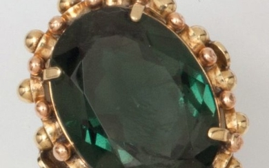 Yellow gold ring, set with a green stone...