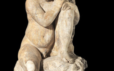 A carved marble figure of a putti