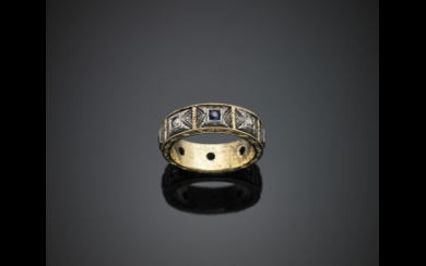 Yellow gold and silver chiselled ring accented with diamonds...
