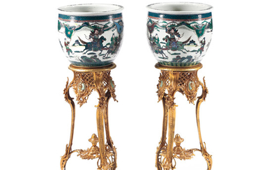 A Pair of Chinese famille verte Porcelain Jardinieres on Gilt Bronze Stands