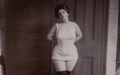 BELLOCQ, E. J. (1873-1949) [Storyville portrait, New Orleans, woman in underclothes standing on rug, about 1900]