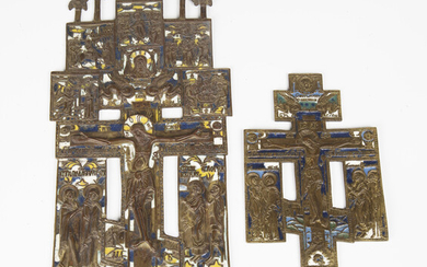 A 19th century Russian cast brass and enamelled icon, incorporating a central crucifix surrounded by