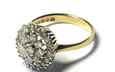 A 9CT GOLD AND DIAMOND CLUSTER RING The arrangement of round...