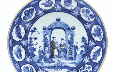 A BLUE AND WHITE 'PRONK ARBOR' SAUCER DISH, QIANLONG PERIOD, CIRCA 1738