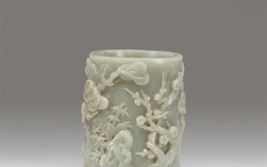 A Chinese carved celadon-grey jade brushpot Qing dynasty, 19th...