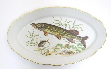 A French oval serving dish with a lobed rim, decorated