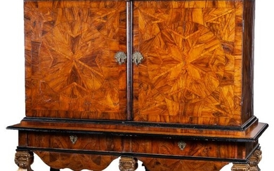 A French walnut marquetry cabinet with Maltese crosses...