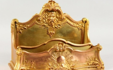 A GOOD FRENCH ORMOLU LETTER RACK, cast with a male mask