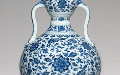 A RARE BLUE AND WHITE DOUBLE-GOURD VASE, YONGZHENG MARK AND PERIOD | 清雍正 青花纏枝蓮紋雙耳葫蘆尊 《大清雍正年製》款