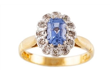 A SAPPHIRE AND DIAMOND CLUSTER RING, of oval form, mounted i...
