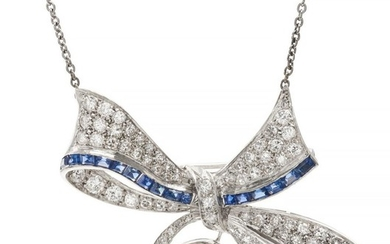 A SYNTHETIC SAPPHIRE AND DIAMOND PENDANT/BROOCH
