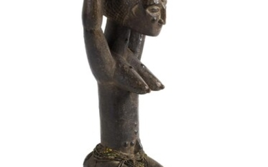 A WOODEN FIGURE OF A FEMALE ANCESTOR