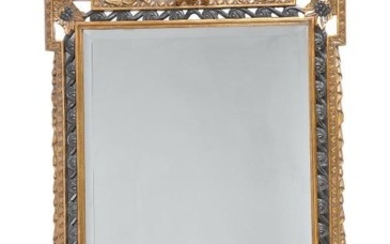 A carved gilt and ebonised framed wall mirror in George II style