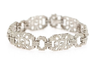 A diamond bracelet set with numerous baguette- and brilliant-cut diamonds, totalling app. 4.65 ct., mounted in 14k white gold. L. 19.5 cm.