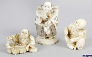 A late 19th century small Oriental carved ivory figure modelled as a warrior with sword, together with two similar netsukes.