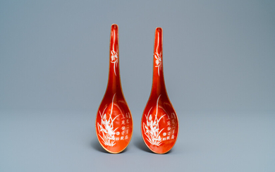 A pair of Chinese reverse-decorated iron red spoons, 19th C.