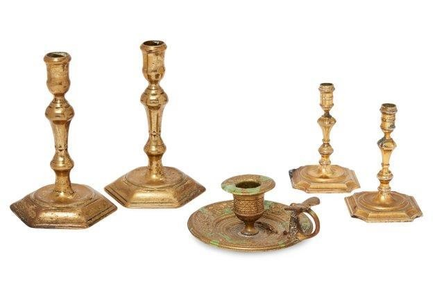 A pair of polished brass candlesticks, 18th...