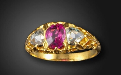 A pink sapphire and diamond three stone ring, the oval-shaped pink sapphire set with rose-cut diamonds in carved and pierced yellow gold mount, size P The pink sapphire with no indications of heat treatment, origin: Burma (Myanmar) as per verbal report...