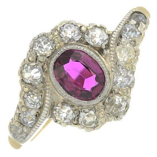 A ruby and diamond cluster ring.Ruby weight