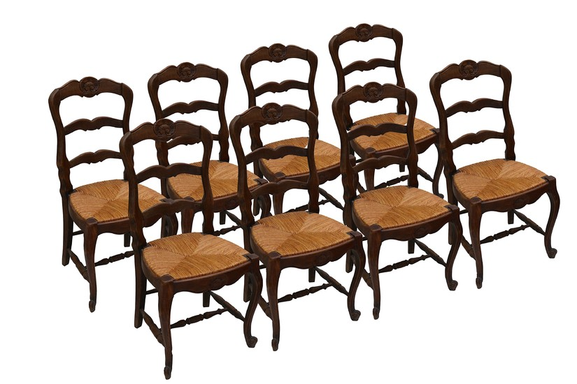 A set of eight French rustic oak ladder back dining chairs