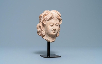 A terra cotta head of a man in Hellenistic style, India, Gandhara, 2nd/4th C.