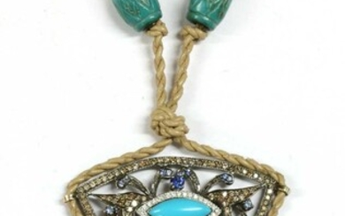 A white gold turquoise, diamond and sapphire pendant