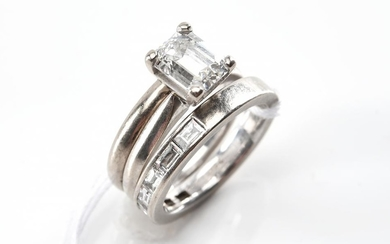 AN EMERALD CUT DIAMOND RING OF 1.54CTS WITH A FITTED WEDDER AND DIAMOND SET BAND ALL IN 18CT WHITE GOLD, ACCOMPANIED BY A COPY OF GI...