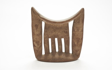 AN ETHIOPIAN KAMBATTA CARVED NECKREST LATE 19TH CENTURY/ EARLY 20TH CENTURY