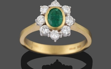 An 18 Carat Gold Emerald and Diamond Cluster Ring, the...