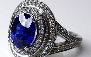 An 18ct white gold, sapphire and diamond dress ring, the dar...