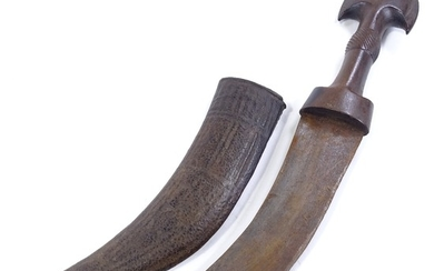 An Antique Arab dagger with carved and shaped horn handle, o...