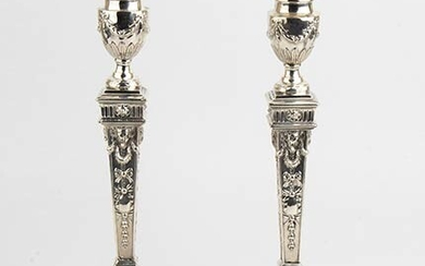 An English pair of sterling silver Victorian candlesticks - London...
