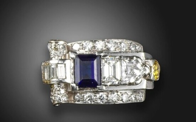 An Odeonesque sapphire and diamond ring, set with an emerald-cut sapphire within scrolling border of diamonds and terminating in a fancy yellow diamond, in platinum, size J
