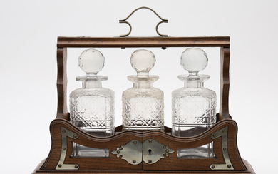 BOTTLE BOX, SO-CALLED TANTALUS, WITH THREE BOTTLES, BEGINNING OF THE 20TH CENTURY.