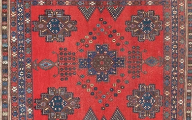Blue and red ground rug with all over geometric design,