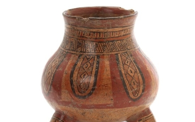 Costa Rica tripod jar of red-fired clay decorated in colours with design, feet shaped like animal heads. 1000–1400. H. 15.5 cm.