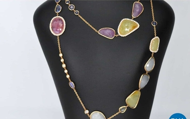 Gold chain with diamonds and precious stones.