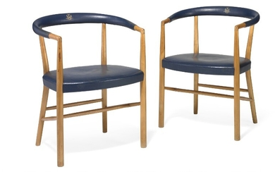 "Jacob Kjær: ""UN Chair"". A pair of armchairs with cherry wood frame. Seat and back upholstered with original blue leather. (2)"